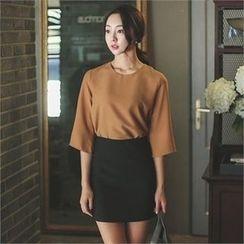 ode' - Zip-Back Mini Skirt