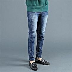 THE COVER - Washed Distressed Skinny Jeans