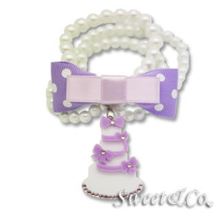 Sweet & Co. - Sweet Purple polka dots bow dolly cake charm pearly bracelet