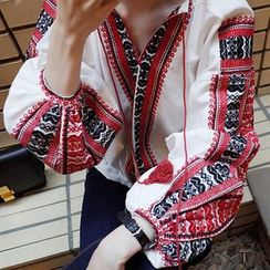 trendedge - Tasseled Tie Neck Embroidered Long Sleeve Top