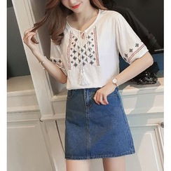 Emeline - Embroidered Tasseled Short-Sleeve Top